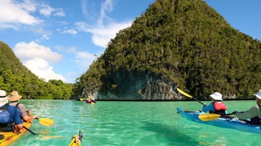 Paddling through Raja's karst islands.