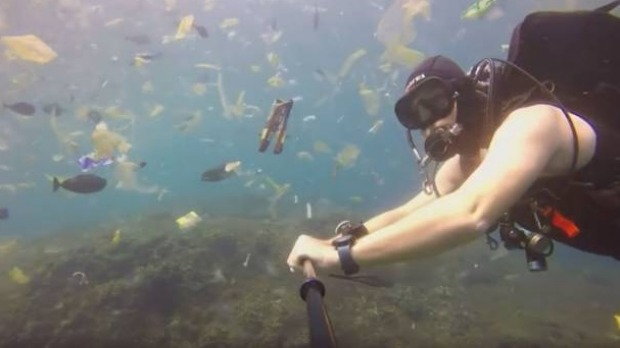 British diver Rich Horner swims through the polluted sea.
