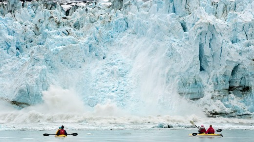 Sea kayakers watching the Margerie Glacier calving into Glacier Bay.