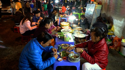 Locals eat at Da Lat night market.
