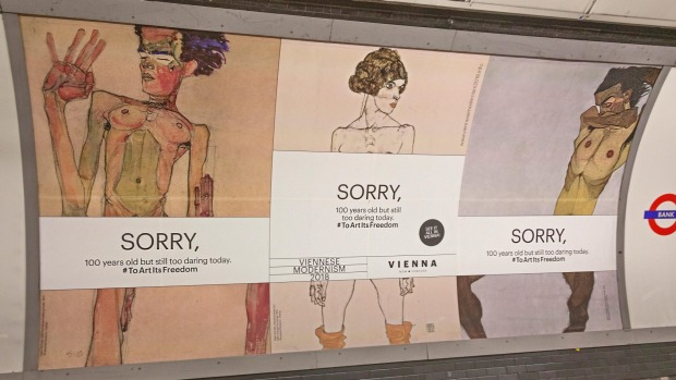 "The offending posters in London's underground with the banner ""Sorry, 100 years old but too daring today."""