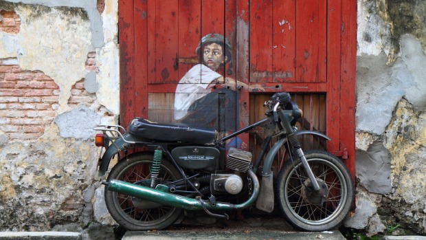 Street art Boy On Bike by Ernest Zacharevic.