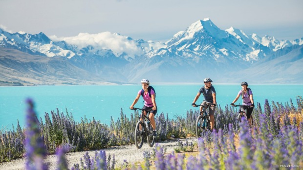 Riders on the track at Lake Pukaki, Canterbury, with Mount Cook in the background.