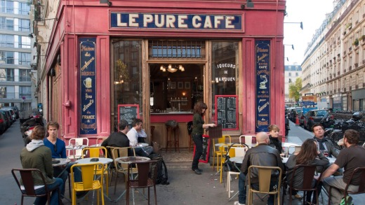 A cafe on a street corner in the Marais district of Paris.