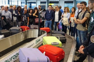 Is it really that hard to stop crowding around the baggage carousel?