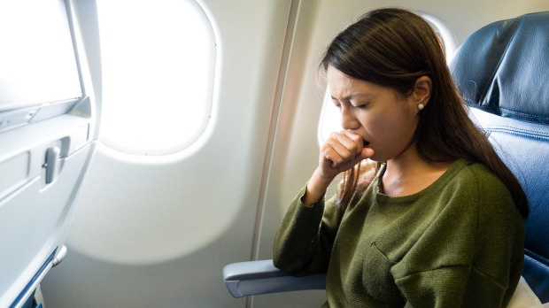 There's only a very small chance of getting sick from a fellow passenger on a plane.