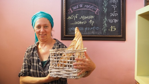 Hadas Meir, who owns Lasha Bakery in Mitzpe Ramon, with some of her handmade loaves.