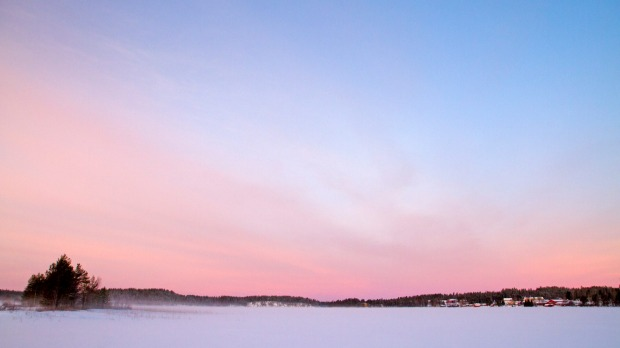 Dawn over Juuma Lake, inside Finland's Oulanka National Park.