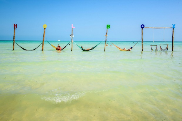 An abundance of hammocks pays ode to the great Mexican tradition of the siesta.