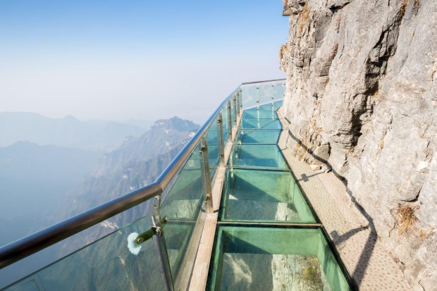 The Coiling Dragon Cliff Skywalk, China: One step up from a box on the side of a mountain is a glass-bottomed walkway ...