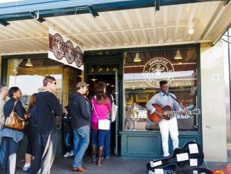 Customer queue in front of the first Starbucks coffee shop in Seattle.