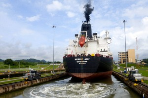 "A tanker passing through Miraflores lock, guided by electronic ""mules""."