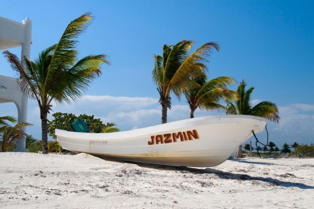 A small motorised boat on the beach at Isla Holbox.