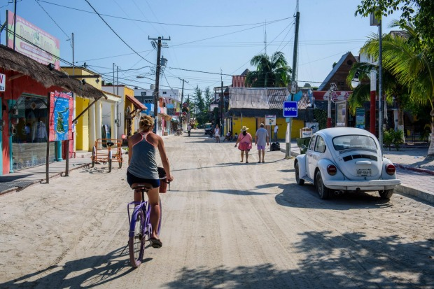 Bikes and VWs in a street of Isla Holbox.