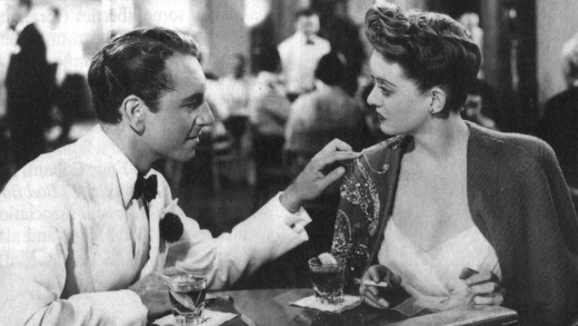Bette Davis (with that cape) and Paul Henreid in 'Now Voyager'.