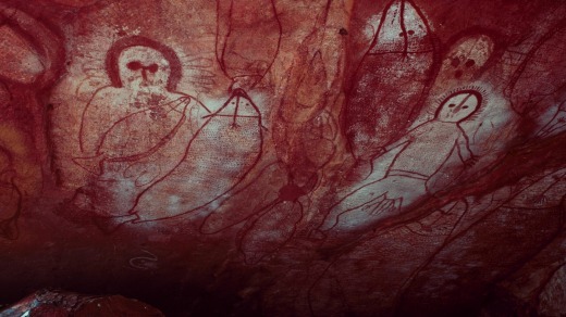 Ancient aboriginal Wandjina rock art in cave, Bigge Island, Western Australia.