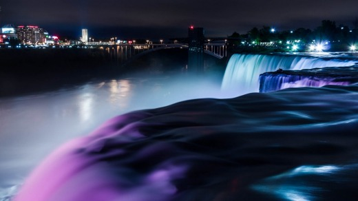 ILLUMINATIONS, NIAGARA FALLS, CANADA. As darkness falls, Niagara Falls glows with multiple colours projected onto the ...