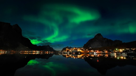AURORA BOREALIS, NORWAY.  The aurora borealis or Northern Lights, unfolding in a kaleidoscope of violets, electric blues ...