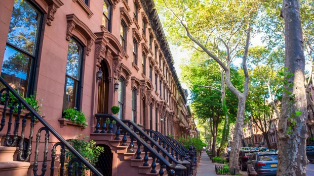 Tree-lined streets and beautiful 19th-century brownstones characterise the Fort Greene neighbourhood of Brooklyn.
