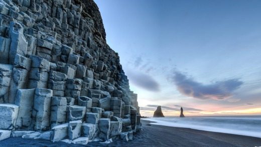 The basalt sea stacks of Reynisdrangar in Iceland.