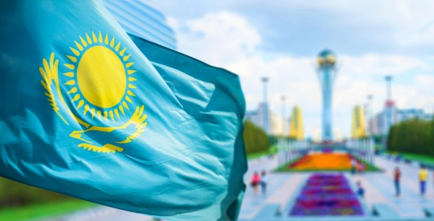 Kazakhstan: The outline of the yellow bird under the sun is wasted because you can't tell it's supposed to be a bird ...