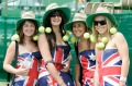 A7JAJ4 Four young patriotic female tennis fans wearing the Australian flag.
