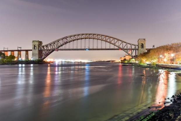 Hell's Gate Bridge at night, in Astoria, Queens, New York.