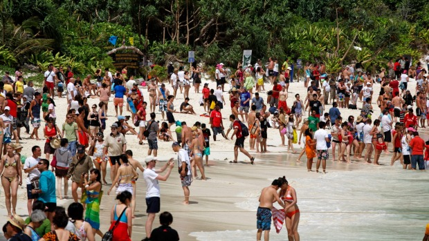 Crowds of people at Thailand's 'The Beach', Maya Bay.