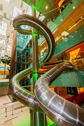 A giant slide - Singapore: Singapore's Changi airport has a whole succession of unusual gimmicks, and one of these is ...