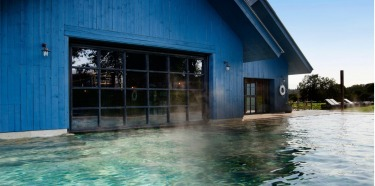 Soho Farmhouse, England: How's this for luxury: a pool within a lake, a converted boatshed that now houses swimming ...