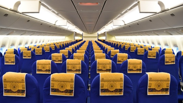 Inside the airline's C-3PO themed Boeing 777.
