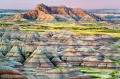 Colorful formations jut up from the prairies in Badlands National Park, South Dakota