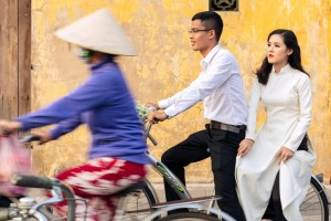 Locals on bicycles in the historic centre of Hoi An, Vietnam.