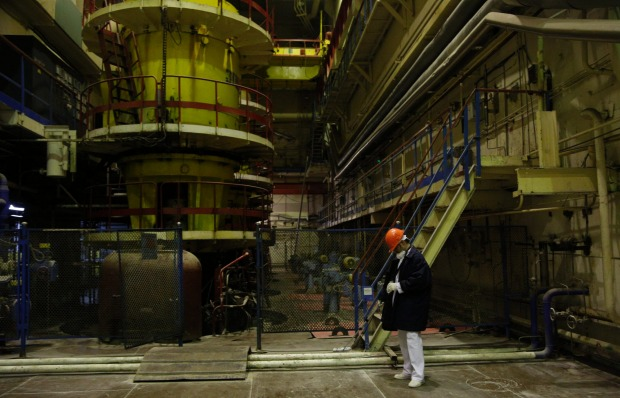 A worker checks the radiation level in the 3rd reactor at the Chernobyl nuclear plant.