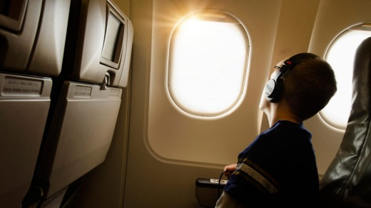 The passenger sitting in the window seat decides whether or not they want their window shade open.