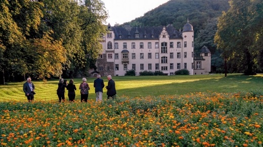 Visitors stroll through the gardens at Namedy Castle.