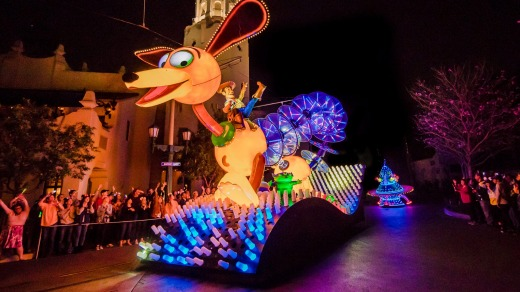 Slinky Dog and Woody from Toy Story in the Paint the Night parade.