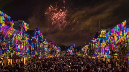 Fireworks explode over Main Street at Disneyland as part of PixarFest.