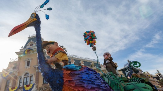 Characters from Up in the Pixar Play Parade.