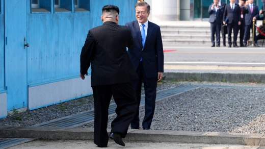 South Korean President Moon Jae-in, right, and North Korean leader Kim Jong Un meet at the border in truce village of ...