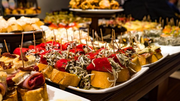 Pintxos on display on the counter of a bar in the Basque region of Spain.