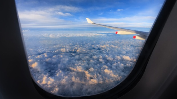The price of airfares would need to rise significantly in order to offset the carbon emissions of tourists, a study has ...