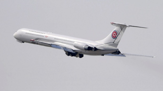 The Soviet-era Ilyushin-62M plane takes off from an airport in Dalian, China.