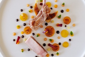 Harmony Farms pork cutlet roasted with verbena, quatre epices scented pumpkin, glazed persimmon and black pudding sauce.