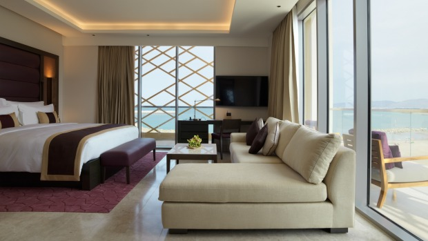 Modern luxury with views: A room at Kempinski Hotel Muscat.