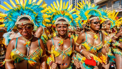 Street procession during an annual carnival in Port of Spain, Trinidad.
