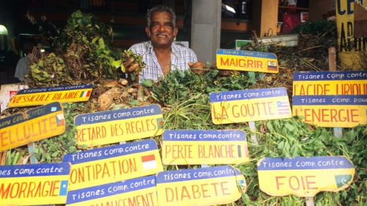 A herbal tea merchant sells his wares at Port Louis Central Marketplace.