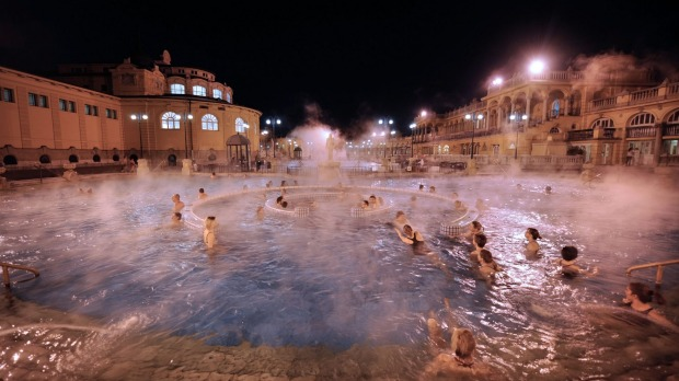 Steam rising off the Szechenyi Baths on a cold winter night in Budapest, Hungary.
