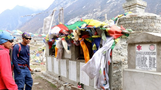 Prayer flags over the memorial mani wall in new Langtang village.