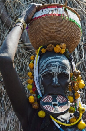 Mursi tribe people with lip plate.